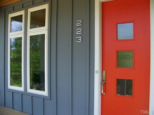 mid century modern home with red door